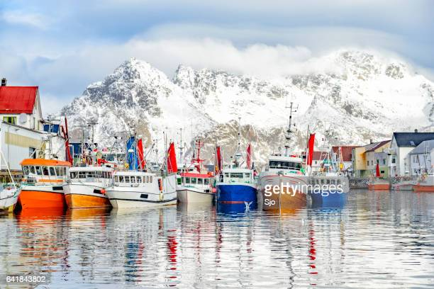 fishing boats in henningsvaer in winter in lofoten archipel, norway - norway stock pictures, royalty-free photos & images