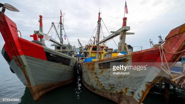 fishing boats in kota kinabalu - shaifulzamri stock pictures, royalty-free photos & images
