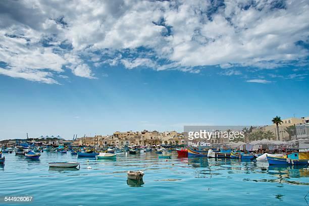 fishing boats in marsaxlokk harbour - marsaxlokk stock pictures, royalty-free photos & images