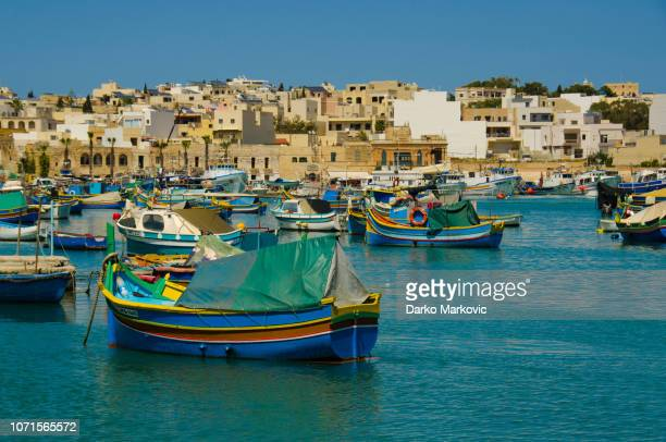fishing boats in marsaxlokk, malta - marsaxlokk stock pictures, royalty-free photos & images