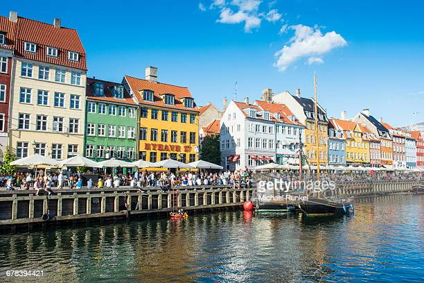 fishing boats in nyhavn, 17th century waterfront, copenhagen, denmark, scandinavia, europe - nyhavn stock pictures, royalty-free photos & images