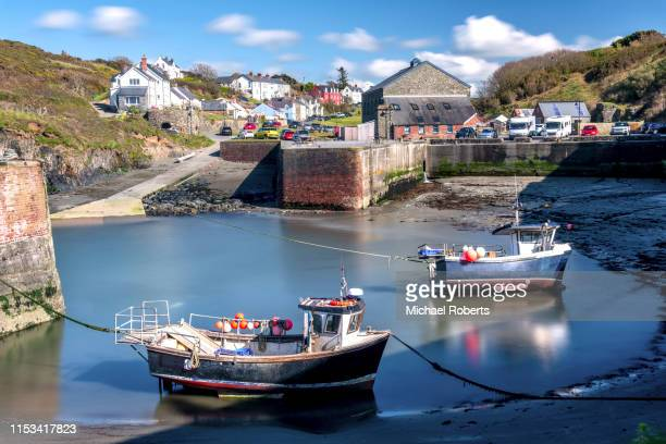 fishing boats in porthgain harbour, pembrokeshire - st davids day stock pictures, royalty-free photos & images