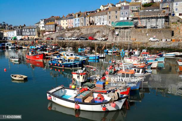 fishing boats in the harbor at mevagissey Cornwall England uk