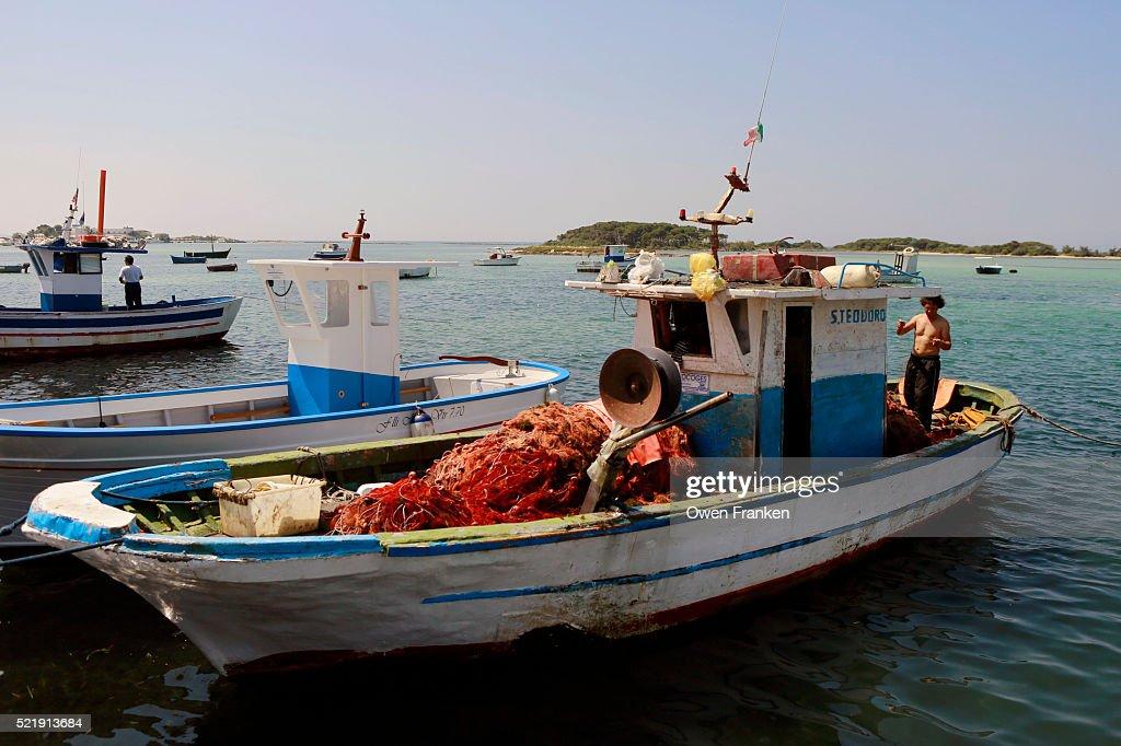 Fishing Boats In The Harbor Porto Caesario Puglia Italy Stock Photo