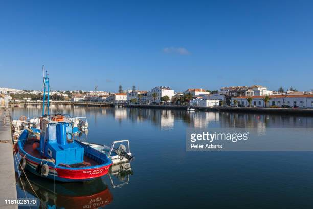 fuseta, portugal - april 2019: fishing boats in the harbour of fuseta, algave, portugal - tradition stock pictures, royalty-free photos & images