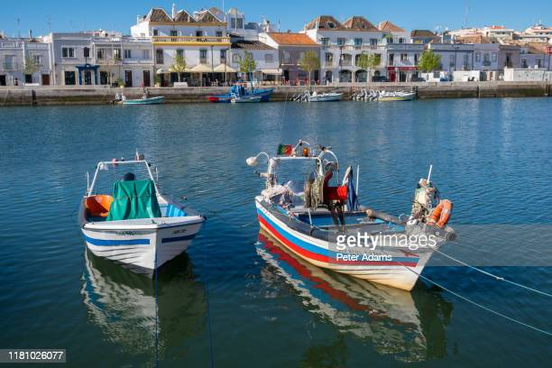 tavira, portugal - april 2019: fishing boats in the harbour of tavira, algave, portugal - faro district portugal stock pictures, royalty-free photos & images