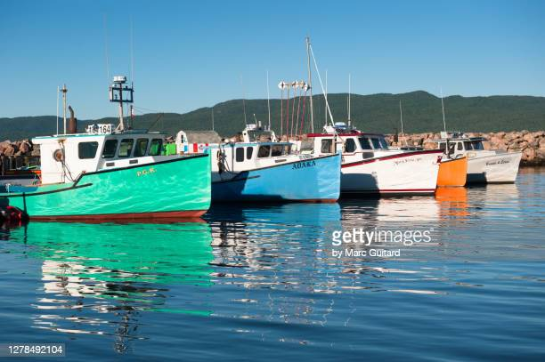 fishing boats in the town of ingonish, nova scotia, canada - cape breton island stock pictures, royalty-free photos & images