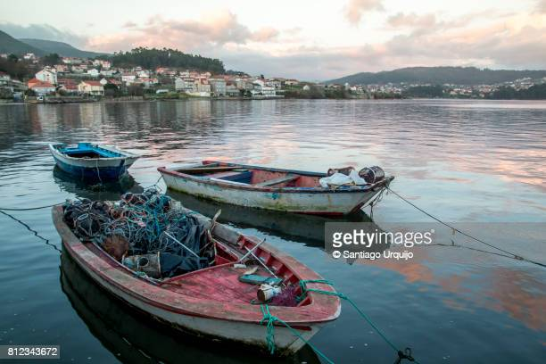 fishing boats in village of combarro - pontevedra province stock photos and pictures
