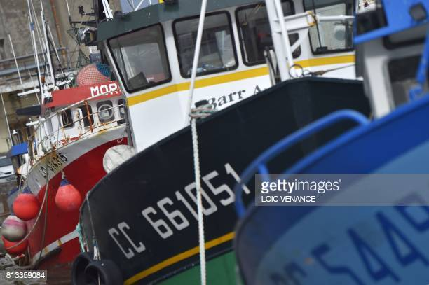 Fishing boats lay at anchor at the Keroman fishing harbour in Lorient on July 12 a day after fishermen found a human foetus in the cold storage of...