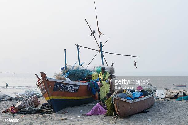 Fishing boats lie on Mumbai's Girgaum Chowpatty beach