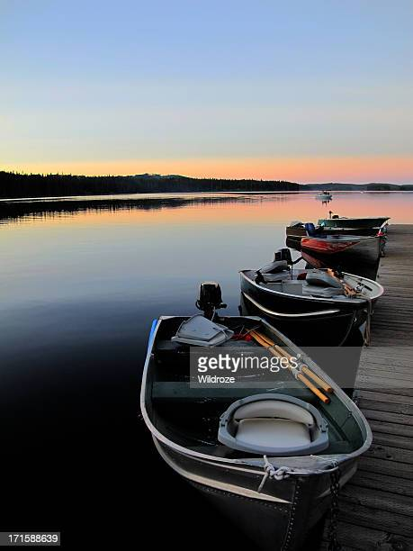 fishing boats line dock at sunset - kelowna stock pictures, royalty-free photos & images
