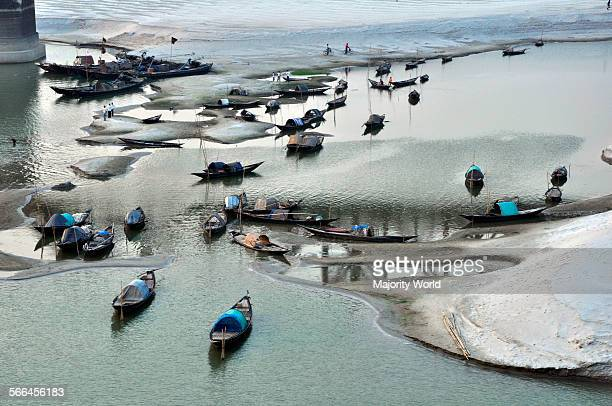 Fishing boats lying on shallow waters of the drying Padma River The river is drying due to withdrawal of the Ganges water at Farakka Barrage in West...