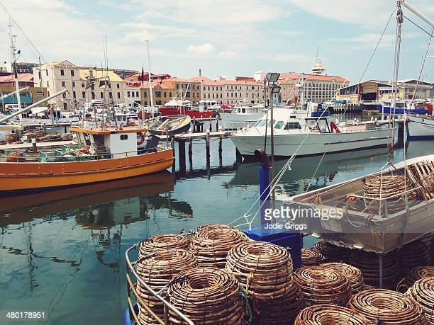 Fishing boats moored at a wharf in a city
