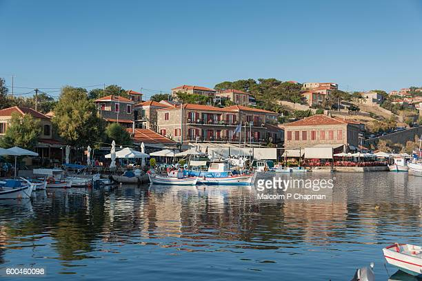 fishing boats moored in molyvos harbour, lesvos, greece. - lesvos stock photos and pictures