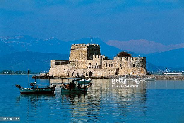 Fishing boats off the Bourtzi island with Castel da Mar Nafplion Greece 15th century