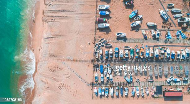 fishing boats on a beach - stock photo - travelstock44 stock pictures, royalty-free photos & images
