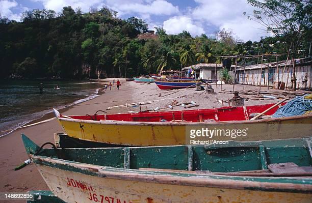 fishing boats on anse la raye beach. - raye stock pictures, royalty-free photos & images