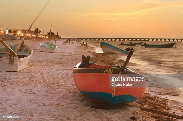 Fishing boats on beach sunset Yucatan, Mexico