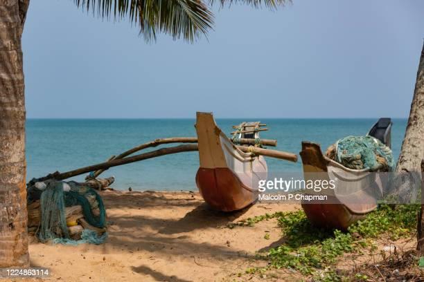 fishing boats on medaketiya beach, tangalle, southern province, sri lanka - sri lanka stock pictures, royalty-free photos & images