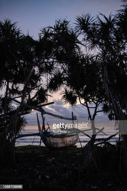 Fishing boats on the coast of Medewi fishing village Bali Indonesia in December 2018
