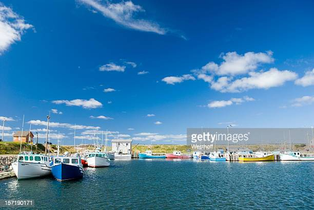 fishing boats on the sea on a cloudy day - cape breton island stock pictures, royalty-free photos & images
