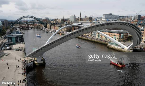 Fishing boats pass under the Millenium Bridge on the River Tyne in North Shields as fishermen take part in a nationwide protest against the Brexit...