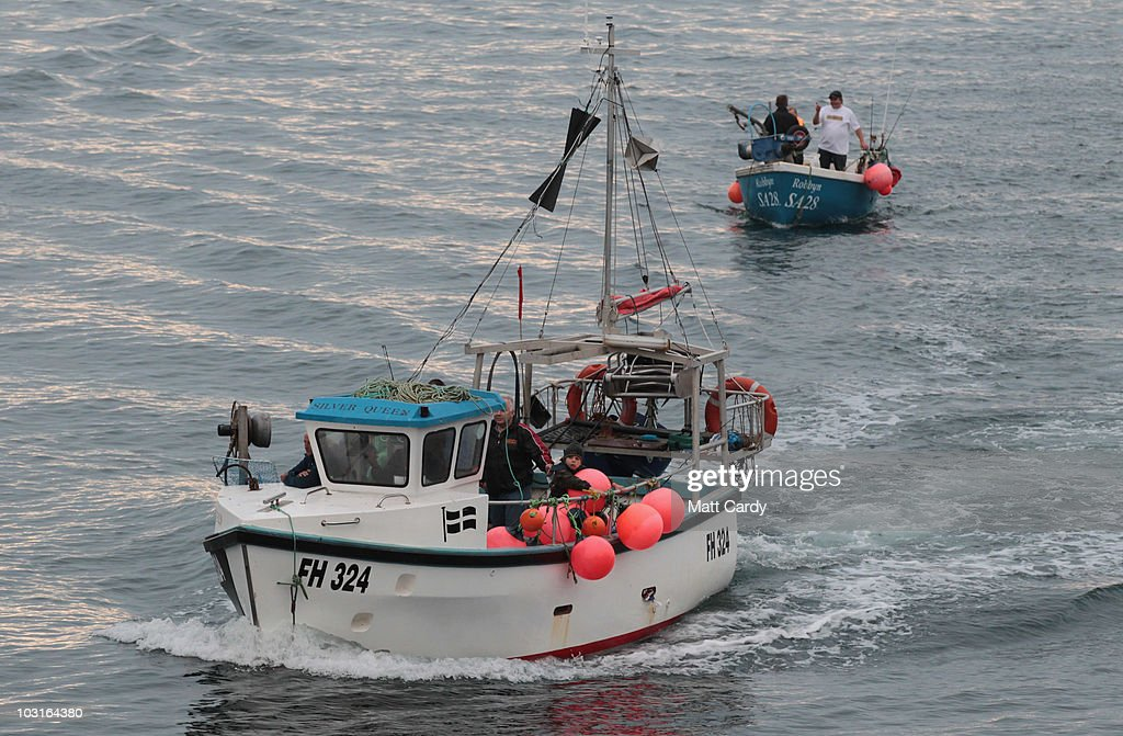 Fishing boats return to Cadgwith cove haven taken part in