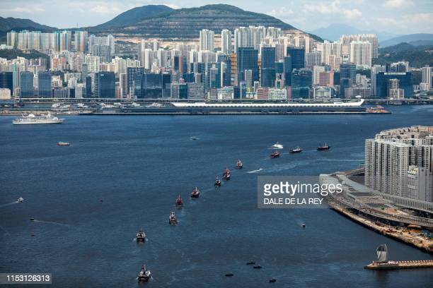 Fishing boats sail through Victoria harbour in Hong Kong on July 1 to mark the city's 22nd anniversary of the handover from Britain to China...