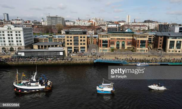 Fishing boats sail up the River Tyne as fishermen take part in a nationwide protest against the Brexit transition deal on April 8 2018 in Newcastle...