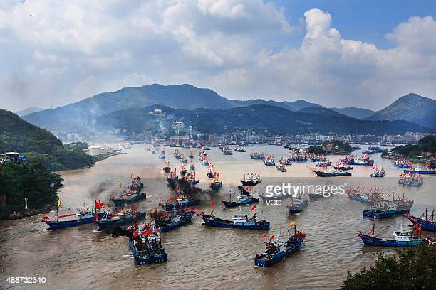 Fishing boats set off from Shipu port for fishing on September 16 2015 in Ningbo China Thousands of fishing boats set sail for fishing after three...
