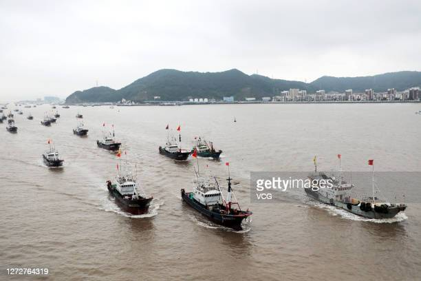 Fishing boats set sail for fishing after the four-and-a-half-month fishing ban on the East China Sea on September 16, 2020 in Zhoushan, Zhejiang...
