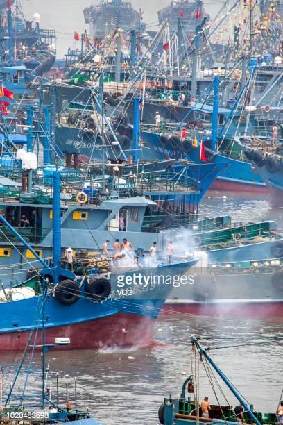 Fishing boats set sail for fishing at Quanzhou port on August 16 2018 in Quanzhou Fujian Province of China Most fishing boats from Xiangzhi town set...