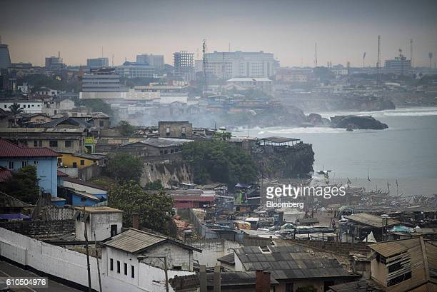 Fishing boats sit on the waterside right near commercial buildings on the city skyline in Accra Ghana on Tuesday Sept 20 2016 Ghana's central bank...