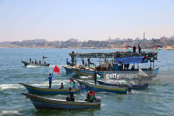 6 fishing boats stand in the Gaza port just before they depart to attempt to break the siege The National Authority for Return and Breaking the Siege...