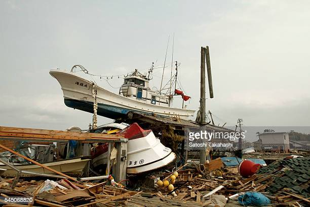 Fishing boats which were destroyed and pushed up on the land by the earthquake and tsunami that hit northeastern Japan on March 11, 2011.