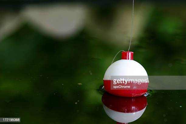 fishing bobber - fishing tackle stock pictures, royalty-free photos & images