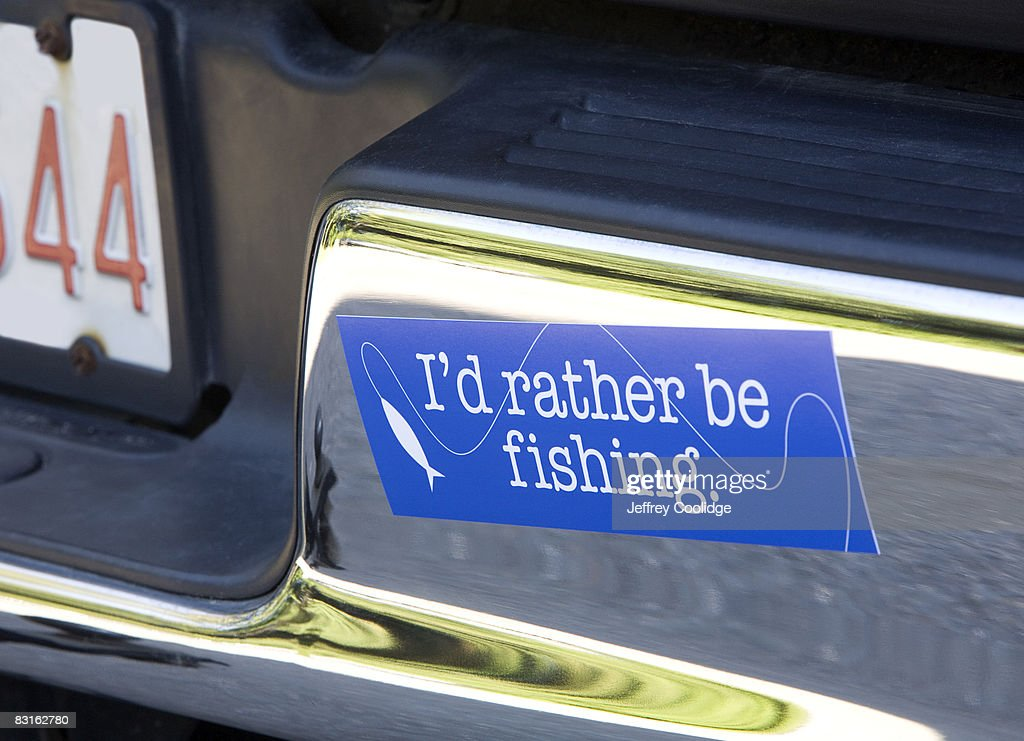 fishing bumper sticker on car : Stock Photo