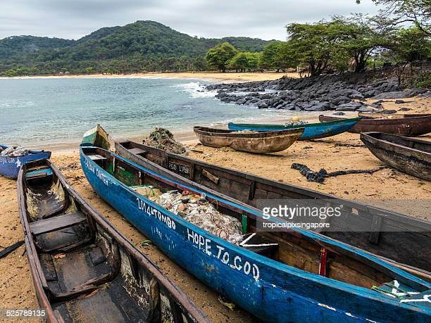 fishing canoes - sierra leone stock pictures, royalty-free photos & images