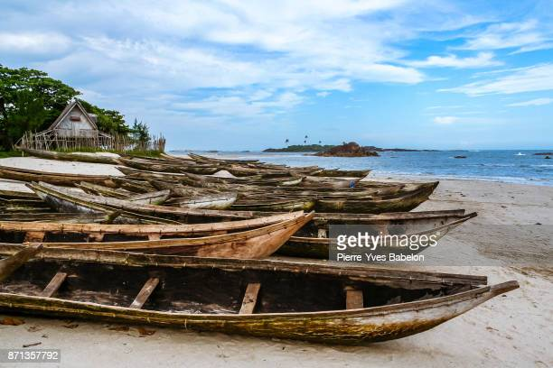 fishing dugout canoes beached - pierre yves babelon stock pictures, royalty-free photos & images