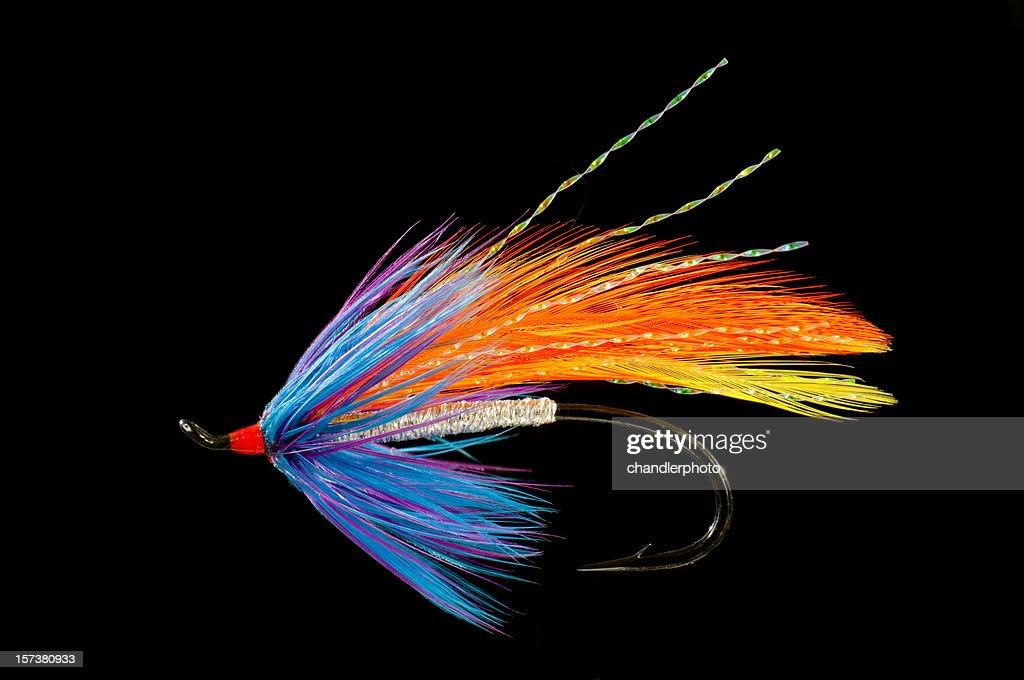 Fishing fly, blue, orange and yellow : Stock Photo
