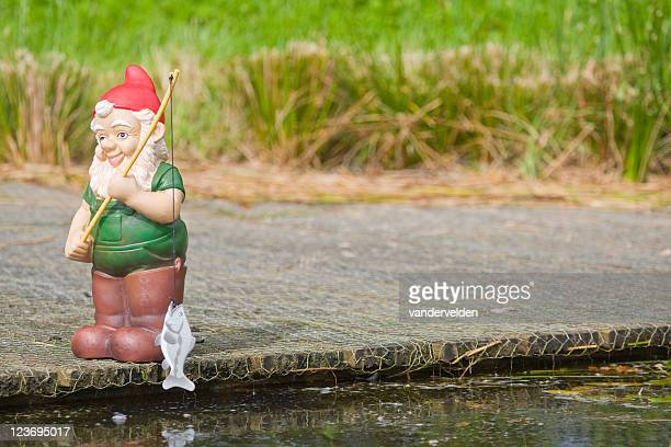 fishing gnome series - garden gnome stock photos and pictures