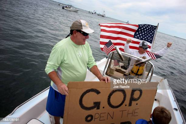 Fishing guide Captain Steve Friedman and friend Sam Kaufman participate in a floating protest asking the US government to stop the shutdown and open...