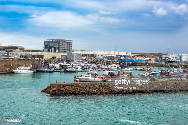 fishing harbor of saint helier - waterfront stock pictures, royalty-free photos & images