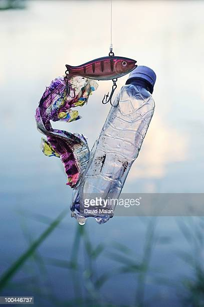 fishing hook with litter caught on it - plastic pollution stock pictures, royalty-free photos & images