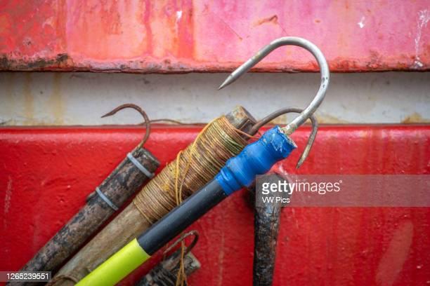 Fishing hooks resting against a boat, Whitby, UK.