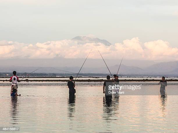 Fishing in Bali with Agung volcano as a background
