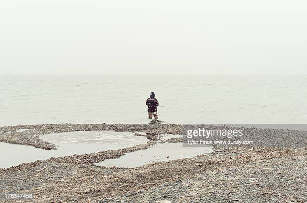 fishing in fog - sursly stock pictures, royalty-free photos & images