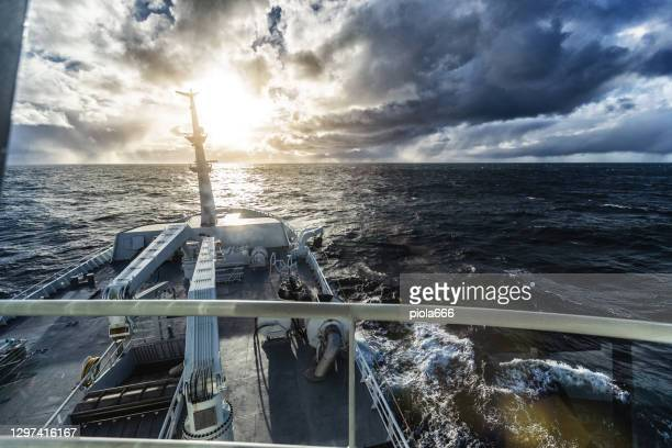 fishing industry: pov from the bridge of a boat sailing ocean - passenger craft stock pictures, royalty-free photos & images
