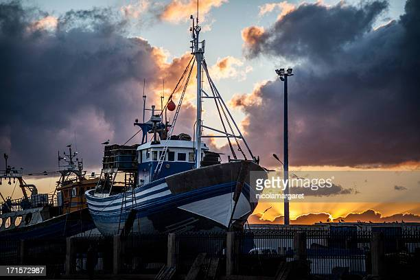 Fishing Industry: Trawler at sunset