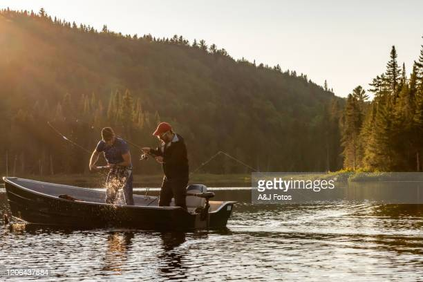 fishing lake in early summer. - fishing industry stock pictures, royalty-free photos & images